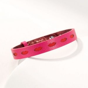 Perforated pink lips and metallic maroon bracelet